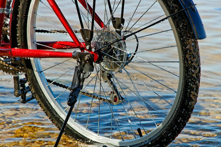 Wet bicycle on the shallow. photo