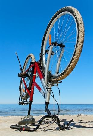 Stabile bike on the beach. Stock fotó