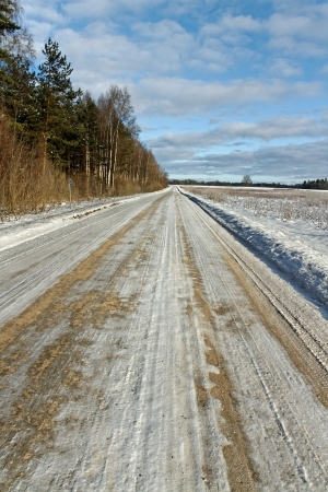 gravelly: Country road in a winter season. Stock Photo