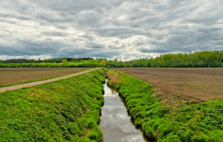 Ditch on the field in a spring time. Stock Photo