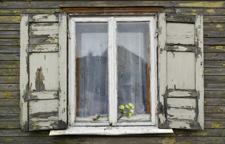 Old window with wooden shutters. photo