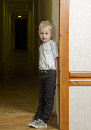 Alone boy at the doorway  photo