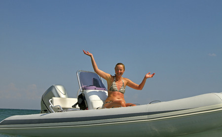 Woman on the motor boat. photo