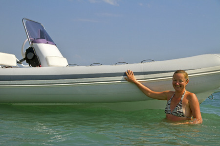Woman next to the motor boat. photo