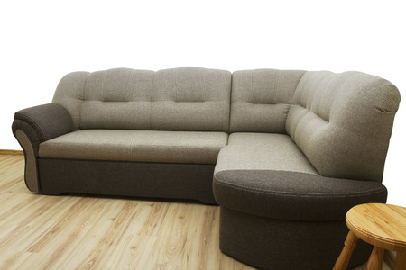 Soft sofa with stool in a flat. Stock Photo