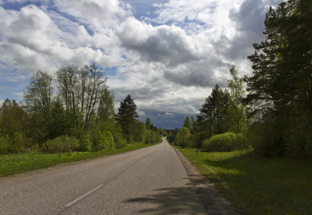 Country road in a cloudy day. photo