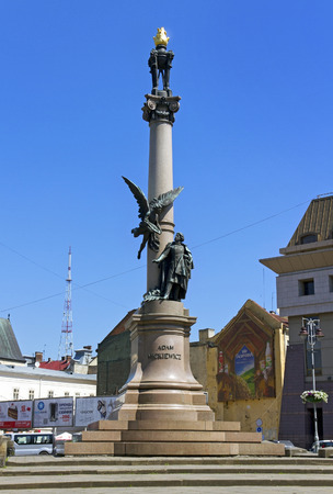 essayist: LVIV, UKRAINE - MAY 9, 2014: Adam Mickiewicz Monument in Lviv, Ukraine. Mickiewicz (1798-1855) was a Polish national poet, essayist, translator, publicist and political writer. Cityscape of Lviv on 9 May 2014. Editorial