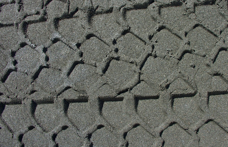 Impression of the wheel on volcanic rock Etna, Italy. photo
