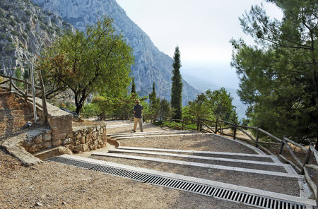 Stair to the ruins in the archaeological site of Delphi in Greece. photo