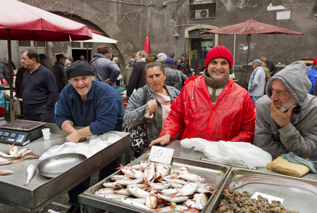 CATANIA - APRIL 05: sellers and bayers on the famous fish market in Catania. This market is also tourist attraction in Catania, Sicily, Italy on April 05, 2014. Stock Photo - 29327041