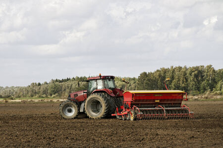 seed drill: Tractor working on the field.