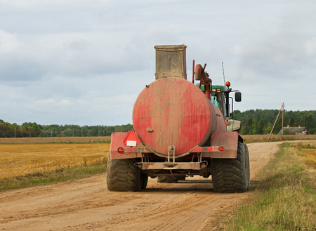 Tractor on the country road.  photo