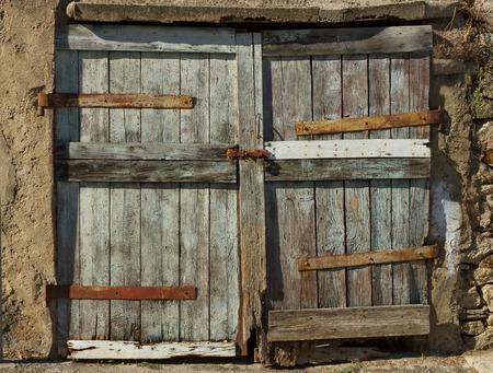 Closed big old door with rusty key. photo