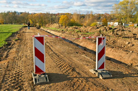 Stop barrier on the gravel road. photo