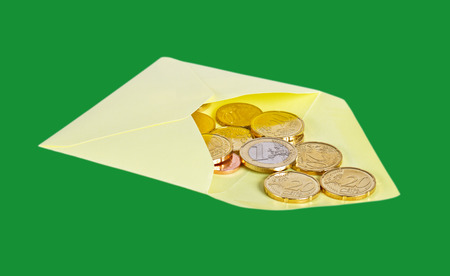 Envelope with euro money isolated on green surface. photo