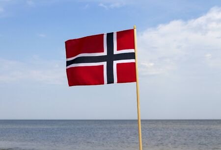 norway flag: Norway flag at the sea. Stock Photo