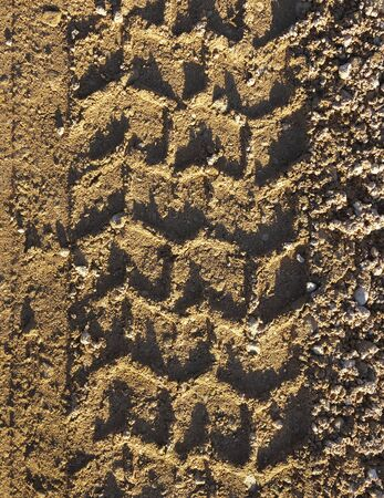 road surface: Country road surface with stamp of wheel. Stock Photo