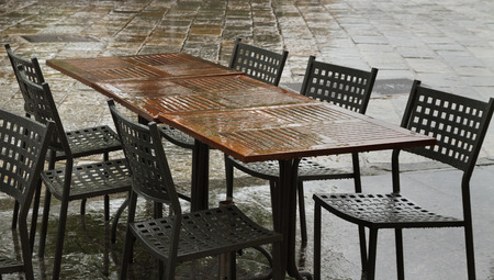 Closed cafe in rain time, Italy. photo