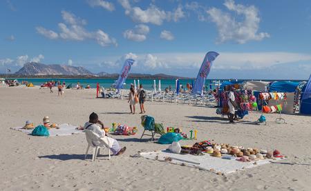 cinta: SAN TEODORO, ITALY - SEPTEMBER 20: The beach of La Cinta in the San Teodoro, region Sardinia. Dealers on the beach on 20 September, 2015, Italy. Editorial