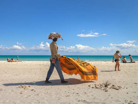 cinta: SAN TEODORO, ITALY - SEPTEMBER 20: The beach of La Cinta in the San Teodoro, region Sardinia. Dealer on the beach on 20 September, 2015, Italy. Editorial