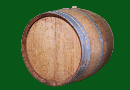 fermenting: Wooden wine barrel, isolated on the green.