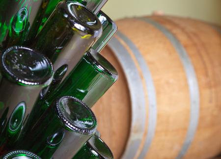 emty: Emty bottles and barrel in a cellar.