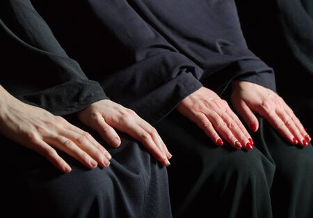 submissiveness: Womens hands on knees. Stock Photo