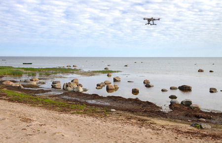 Stone Baltic sea in a spring time - paradise for birds. Flying drone above water.