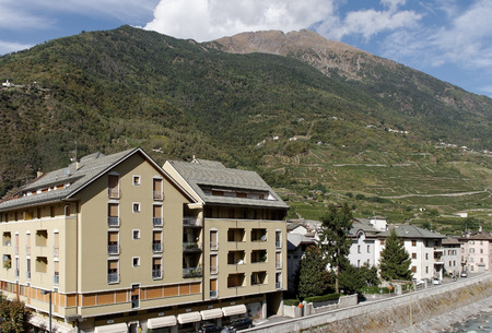 TIRANO, ITALY-OCTOBER 2, 2012: Tirano is a town what adjacent to the Switzerland-Italy boundary. The river Adda flows through the town. View to the city of Tirano on 2 October 2012, Italy. Editorial