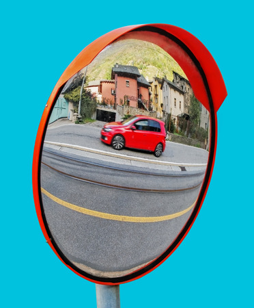 Isolated security mirror on the street, Italy. Stock Photo