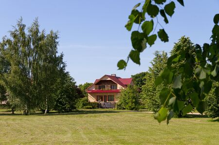 fasade: Fasade of detached house, summer.