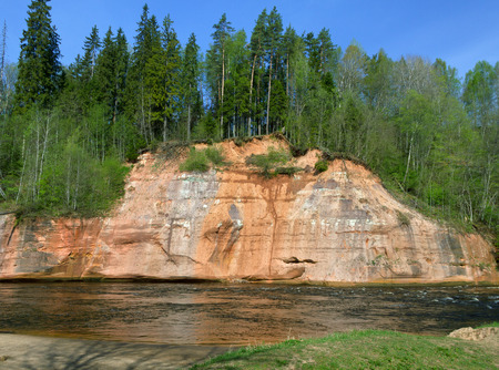 Sandstone cliffs by the river Gauja, national park in Latvia.