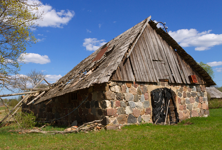 Natural homestead with holey roof of barn.