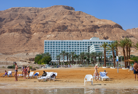 ISRAEL, DEAD SEA - OCTOBER 31: The Dead Sea is a salt lake bordered by Jordan to the east and Israel and Palestine to the west. It was one of the worlds first health resorts. Relax at the Dead sea on 31 October 2016. Editorial