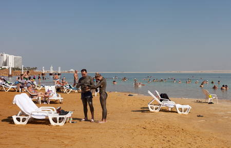 bordered: ISRAEL, DEAD SEA - OCTOBER 31: The Dead Sea is a salt lake bordered by Jordan to the east and Israel and Palestine to the west. It was one of the worlds first health resorts. Relax at the Dead sea on 31 October 2016. Editorial