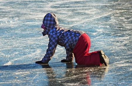 fallin: Small girl fallin down on the ice.
