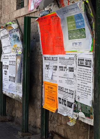 jewish community: ISRAEL, JERUSALEM - OCTOBER 30: Jerusalem is one of the oldest cities in the world.  Posters of the orthodox jewish community on the street of Jerusalem on 30 October 2016.