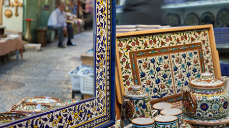 Ceramic tableware and mirror on a market in the old town in Jerusalem.