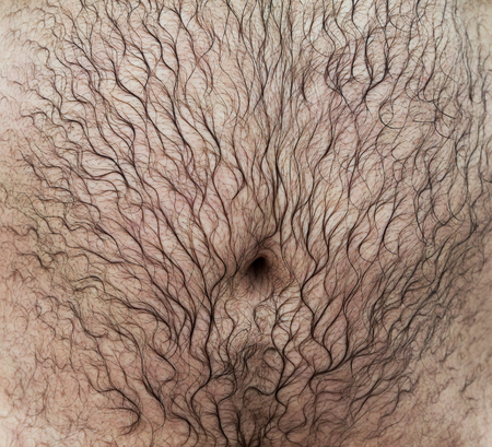 Wet belly of a man with hair.