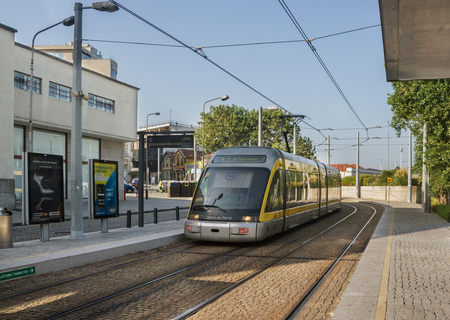 PORTO, PORTUGAL - 5 SEPTEMBER:  Porto is one of the oldest European centres. Light rail is urban public transport what caming to the outside station on 5 Septemver 2016, Porto, Portugal. Editorial