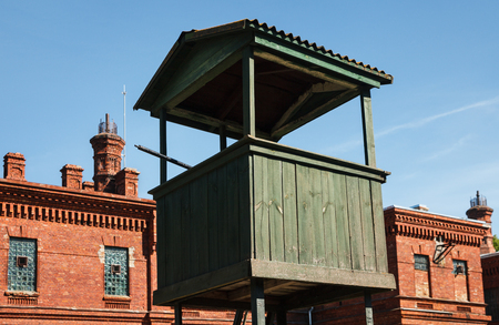View to the watchtower on prison museum in Latvia. Banque d'images - 120013424