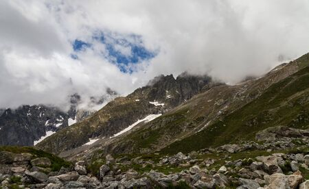 View to the Mont Blanc in cloudy time from cableway skyway station in Courmayeur, Italy.