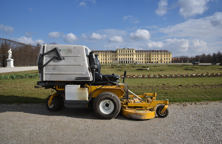 AUSTRIA, VIENNA - MARCH 26: Vienna is capital and largest city of Austria. Park of summer residence of the Habsburg rulers. View to Schönbrunn Palace with mower on 26 March 2019, Hietzing, Austria. Redactioneel