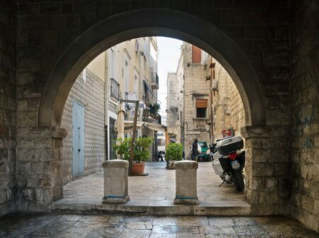 ITALY, BARLETTA - OCTOBER 3: Barletta is located on the Adriatic sea coast. Street with an archway  on morning time, Barletta, 3 October 2017, Italy. 報道画像