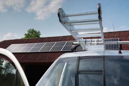 Montage of solar panel on a roof top. Reklamní fotografie
