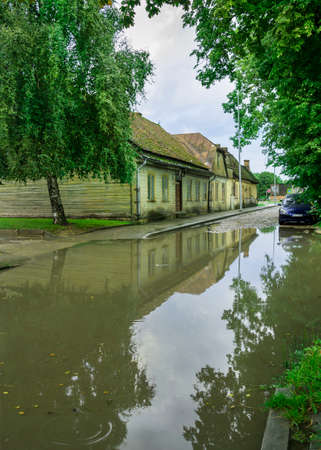 View to small street with big water puddle. Reklamní fotografie