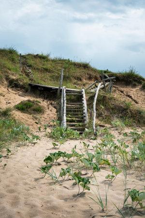 Old wooden stair on the beach in Jurkalne, Latvia. Reklamní fotografie