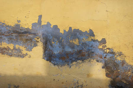 Big diagonal spot on plaster wall. Reklamní fotografie
