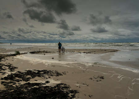 View to coast of Baltic sea with biker. Reklamní fotografie