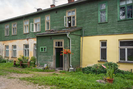 Old wooden house in a small city. Reklamní fotografie